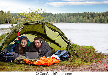 Camping with Laptop by Lake