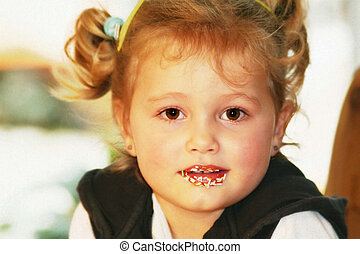 sugar - little girl is nibbling sweets