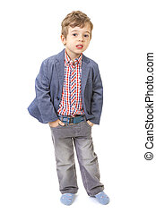 little boy with his hands in pocket
