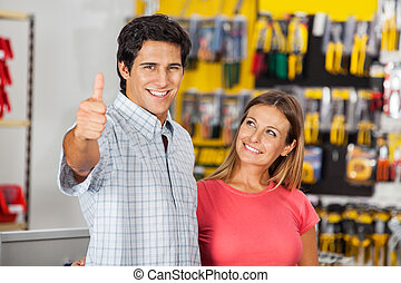 Successful Man With Woman In Hardware Store