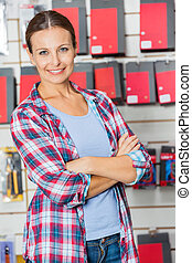Confident Customer With Arms Crossed In Hardware Store