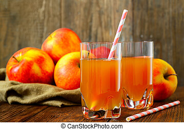 Glass of apple juice with apples on wood background - Glass...