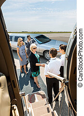 Business People About To Board Private Jet - Airhostess and...