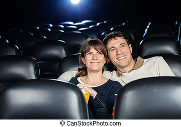 Happy Couple Watching Film In Theater
