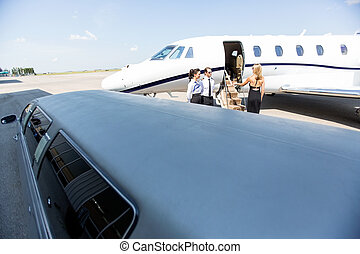 Woman Boarding Private Jet - Woman boarding private jet with...