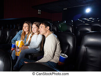 Family Watching Film In Cinema Theater