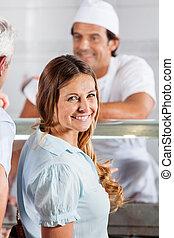 Happy, Woman, In, Butcher's, Shop