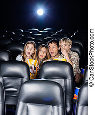 Amazed Family Watching Movie In Theater