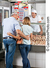 Couple, Standing, In, Butcher's, Shop