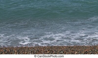 Coastline of Atlantic Ocean - Waves softly lap over pebbles...