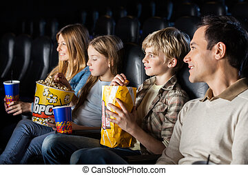 Family Watching Movie In Theater - Family having snacks...