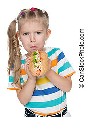 Little girl with hot dog