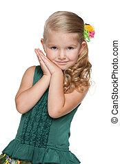 Little girl against the white
