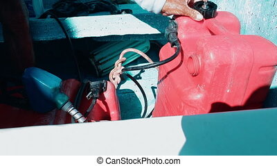 Man fueling tank of a motor boat before travel - Close-up...