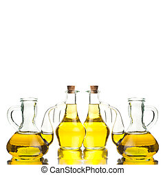 Four glass bottles with extra olive oil