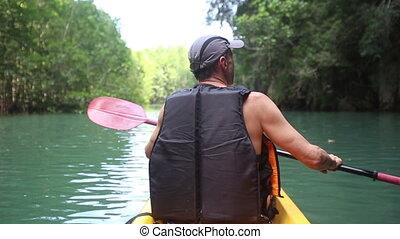 man kayak rowing kayak on the river - elderly man kayak...