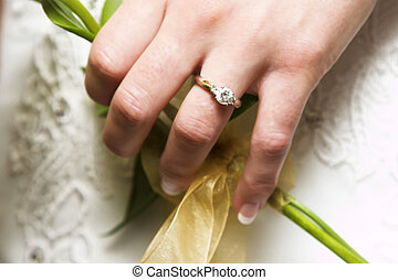 Wedding Ring - Caucasian bride holding her flowal bouquet...