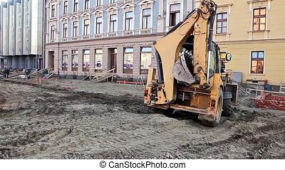 Excavator transports gravel - Gravel being moved around on a...