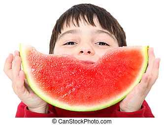 Watermelon Boy - Adorable six year old boy eating sliced...