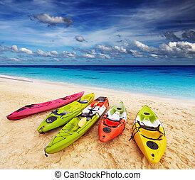 Tropical beach - Colorful kayaks on the tropical beach,...