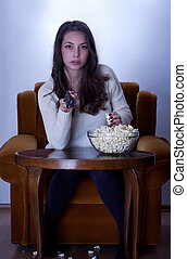 Series junkie. - Portrait of young brunette in front of the...