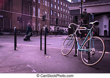 old bycicle on the steet of citty - old colorfull bycicle on...