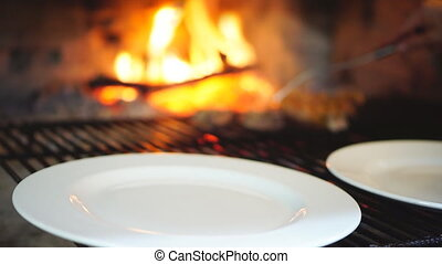 Picking sirloin steaks and t-bone from grill to plate -...