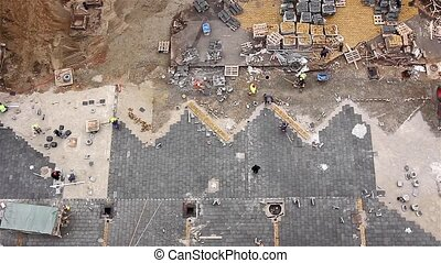 Pavers at work, view above - Workers stack paving slabs on...