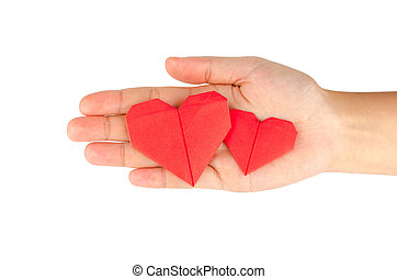 female hand holding paper heart, isolated on white...