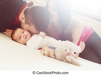 Parents with little baby at home - Happy young parents with...