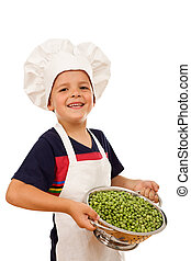 Happy chef with lots of fresh peas