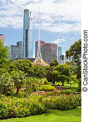 Melbourne Skyline Thru Queen Victoria Gardens - Melbourne,...