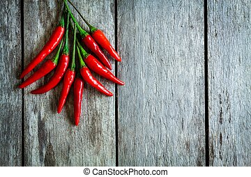 bunch of red hot chili peppers on a wooden rustic background