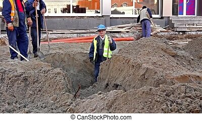 Excavator at Work - Excavator digs trench on the...