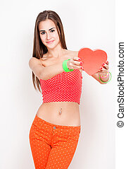 I offer my heart. - Portrait of beautiful cute teen holding...