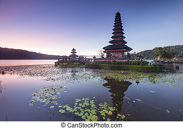bali - Pura Ulun Danu Hindu temple at morning with sunset in...