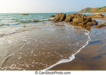 beautiful sandy beach with large stones