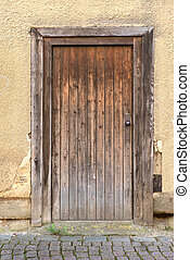 Weathered brown wooden door - Old, weathered, brown wooden...