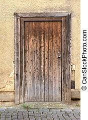 Weathered brown wooden door - Old, weathered, brown wooden...