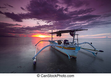 boat - Traditional fishing boats on a beach in Lovina on...