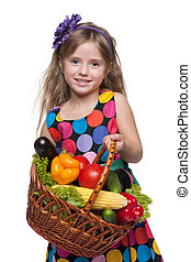 Little girl with a basket of vegetables - A smiling little...