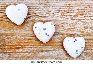love symbol - hearts on wooden background