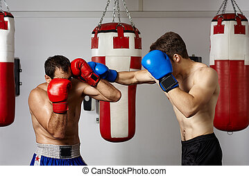 Kickbox fighters sparring in the gym - Two kickbox fighters...