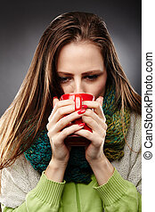 Woman with flu drinking tea