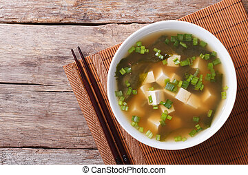 Japanese miso soup in a white bowl horizontal top view -...