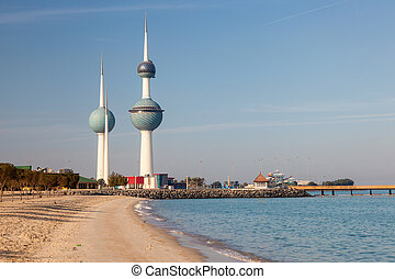 Arabian Gulf beach and the Kuwait Towers in Kuwait City,...