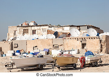 Boats outside of a residential house in Kuwait, Middle East