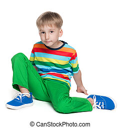 Cute little boy in a striped shirt - A cute little boy in a...