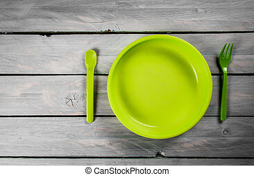 Plate on wood background - Green kids plate on wooden...