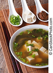 Japanese miso soup and ingredients close-up. Vertical -...
